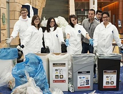Happy people segregating waste