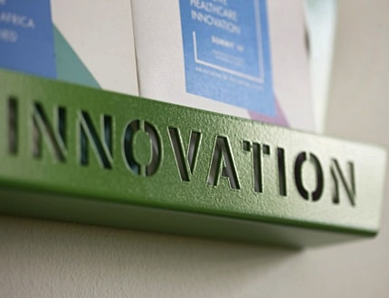 Small green shelf with innovation word