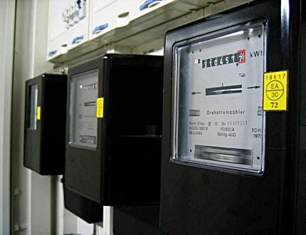 Three black boxes of electric metre