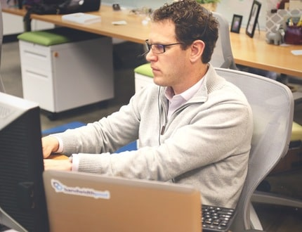 Man busy working on his computer