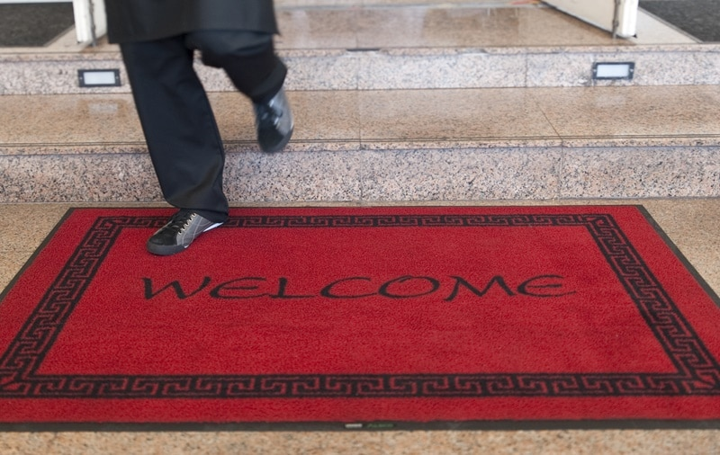Red and black colour combination of welcome mat