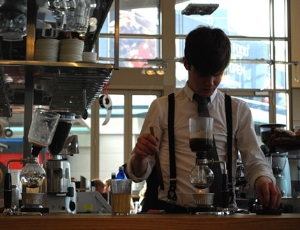 A male employee working on a café