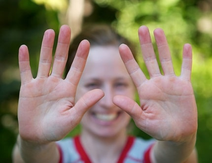 Smiling woman showing her two clean hands