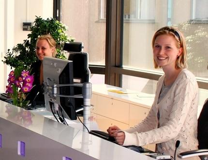 Two women smiling at work