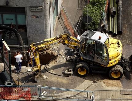 Backhoe loader being used to dig