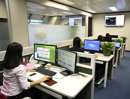 A clean and organised office with four female employees