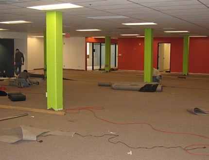 A colourful, wide, and spacious room that is under construction