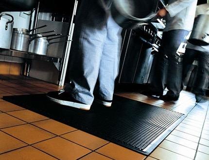Alsco anti-fatigue mat placed in the kitchen for safety