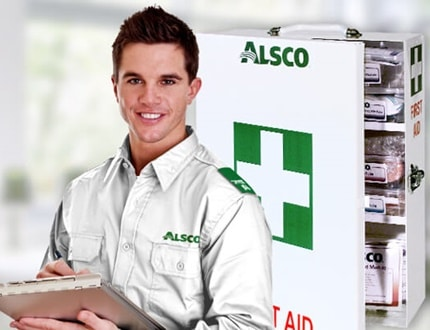 Alsco male employee and Alsco first aid kit in one picture