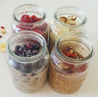 Four jars with healthy foods inside