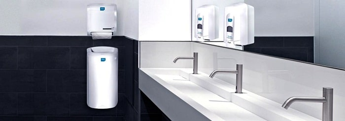 Clean washroon with soap dispensers by Alsco