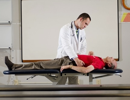 Physician checking his patient