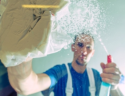 Man wearing blue cleaning