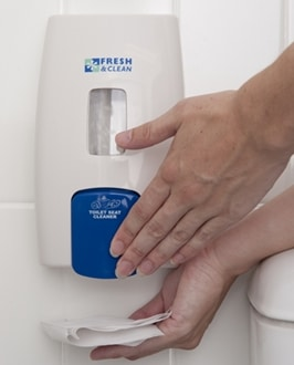 person dispensing toilet seat sanitiser