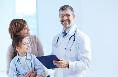 smiling male doctor with the two patients