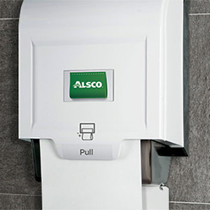 Alsco white paper towel dispenser mounted on the wall