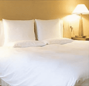 all white beddings with warm lighting