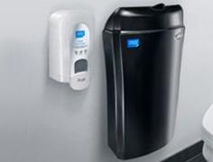 black feminine waste bin and a white air freshener