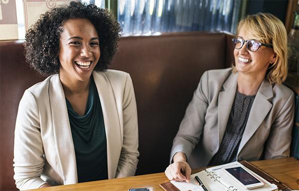 happy women wearing corporate attire