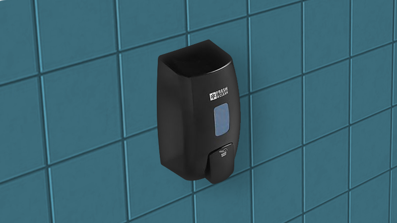 black soap dispenser mounted on the blue green wall