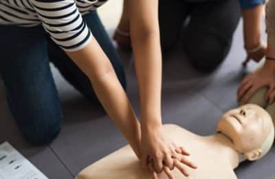 First aider offering basic first aid