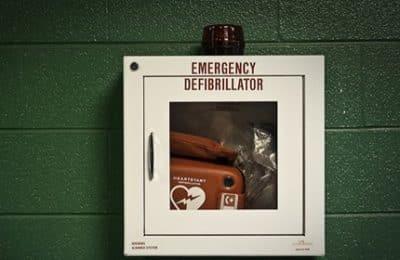 Stationed emergency defibrillator