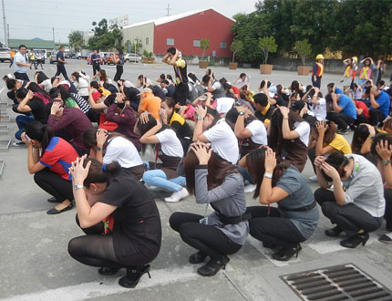 people performing earthquake drill