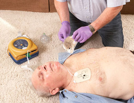 first aid procedure using AED to an old male