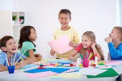 five happy children doing art crafts