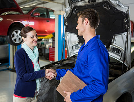 female client and male mechanic shaking hands
