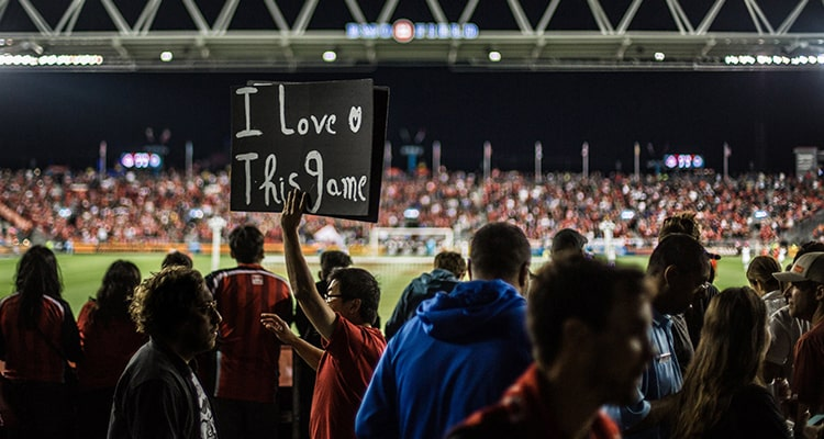 Fan With Sign At Soccer Game