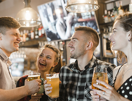 group of happy people holding a glass of drinks