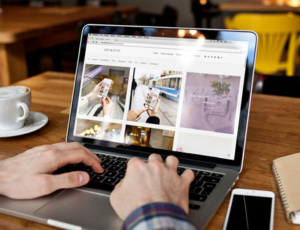 person using a laptop searching for images
