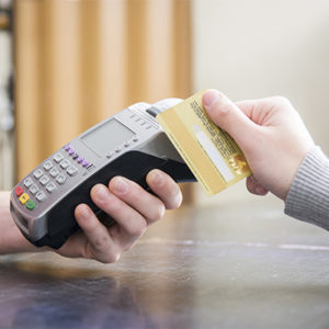 different people holding a credit card and terminal for payment