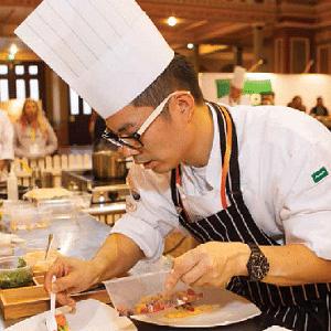 asian chef preparing dish