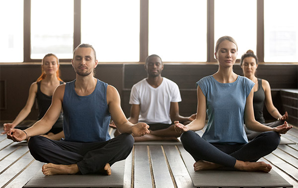 group of people doing a yoga post