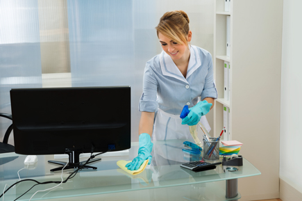woman cleaning a work desk