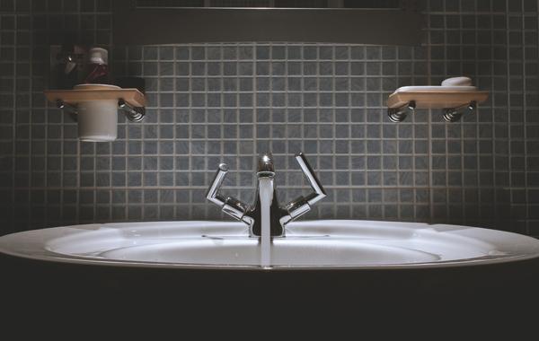 grey steel faucet bathroom sink