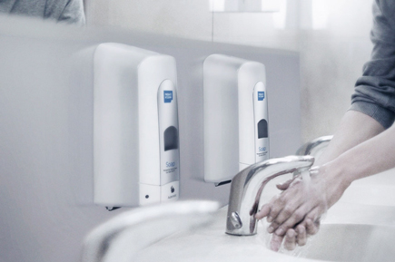 person washing hands using alsco product