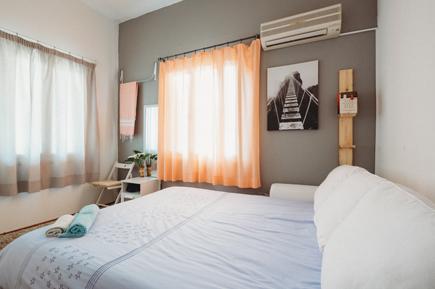 white bedspread insde room