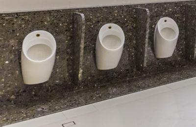 Men waterless urinals