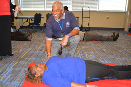 first aid officer having cpr training
