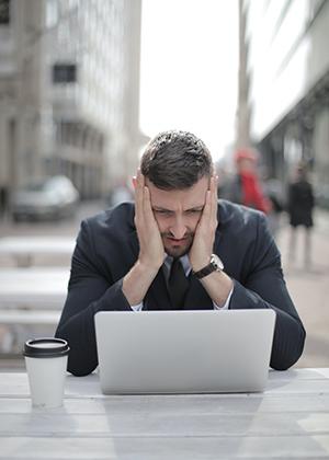 pensive man looking at computer